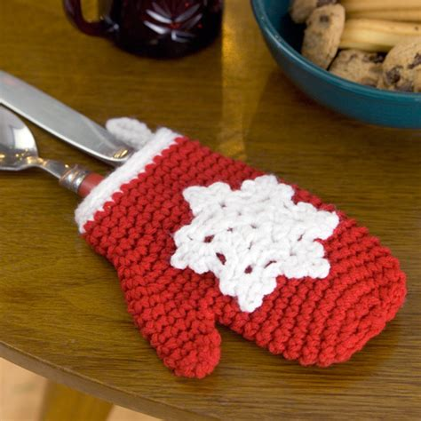 crochet christmas crafts snowflake mitten ornament crochet pattern from yarn favecrafts