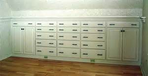 pic 1 drawers and cabinets are built in to the knee wall