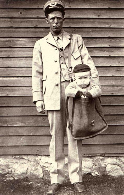 Postal Service Letter Carrier Description Uniformed Letter Carrier With Child In Mailbag Description Flickr Photo