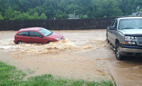 overnight boat rental lake of the ozarks flash flood alert lake area streets under water after