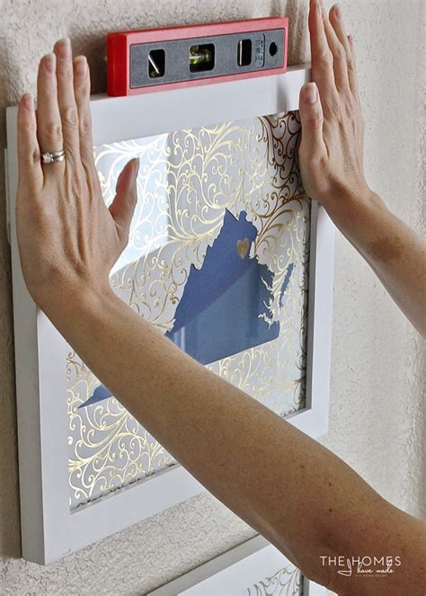 hanging a gallery wall without nails how to hang a gallery wall with command strips the homes
