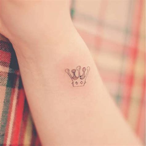 wrist crown tattoo 60 wonderful crown tattoos for your writs