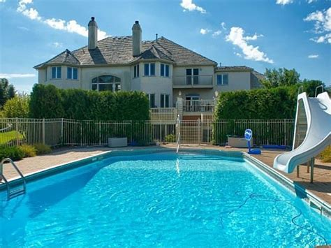 2 story house with pool house wow two story windows overlook outdoor pool in