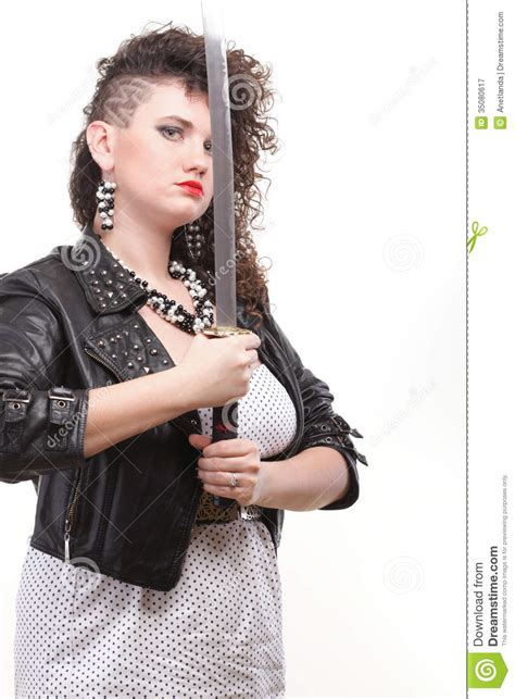 hair cut with samuri swords piercing woman curly girl with unique haircut and sword