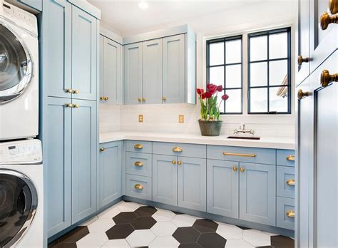 blue cabinets giggles and laundry blue shaker laundry cabinets with brass knobs and pulls