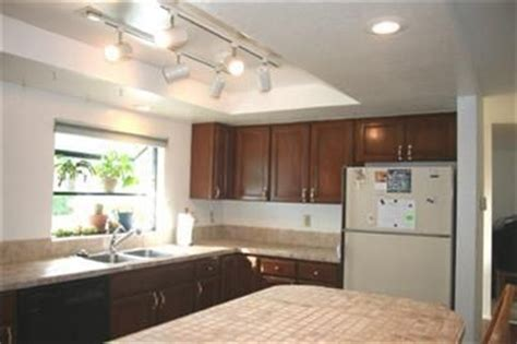 update kitchen lighting updating look of recessed fluorescent fixtures diy home improvement remodeling repair