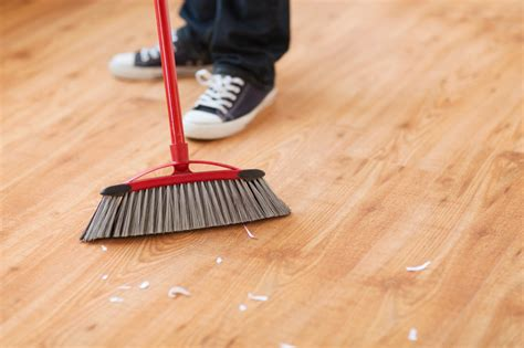 Sweeping The Floor by How To Care For Engineered Hardwood Flooring