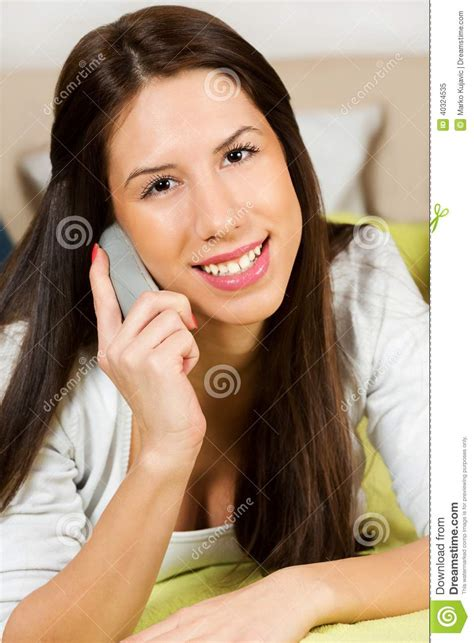 girl with mobile phone in bedroom stock photo image girl text messaging on cell phone in her bedroom stock