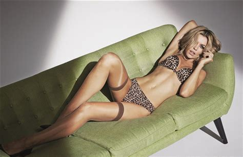 lorena sizzles as she poses on the bed wearing a hot black abbey clancy sizzles in new ultimo shoot