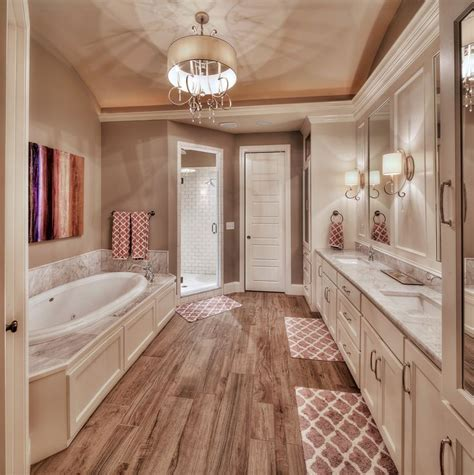 her in bathroom master bathroom hardwood floors large tub his and her