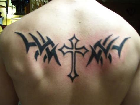 tribal cross tattoos on back outline cross and tribal on back