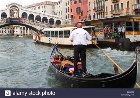 canal boat italy 4 boat bridge canal city color image day gondola gondolier