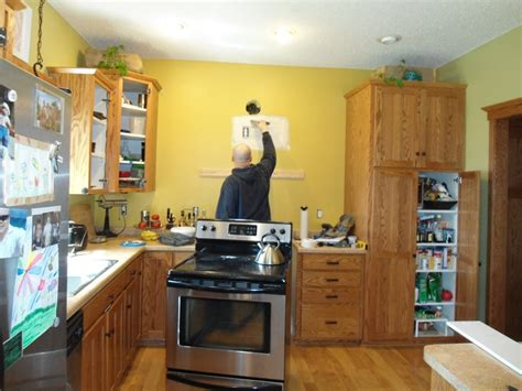 yellow kitchen walls with oak cabinets kitchen before the cabinets are really well made but the