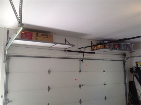 Shelf Racks Garage by High Ceiling Garage Remodel Design With Wood Wall Mounted