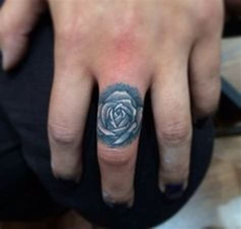 33 beautiful rose finger tattoos