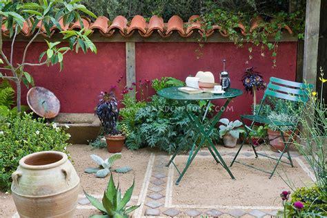 mediterranian courtyard gardens courtyards and verandas pinterest outdoor room furniture walls plant flower stock