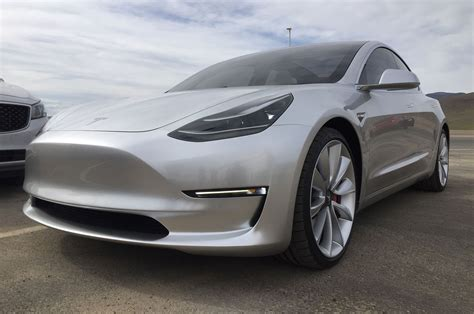 who is telsa tesla model 3 live pictures emerge from gigafactory