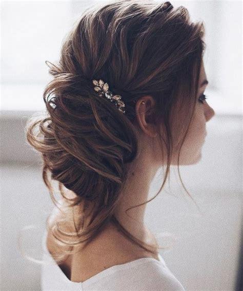 bridal hairstyles loose bun new stylish loose low bun wedding hairstyles 2017 2018