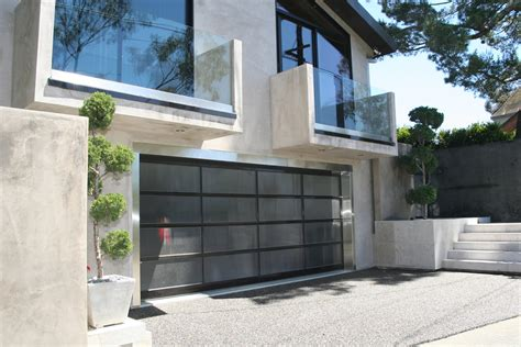 Modern House With Glass Walls by Frosted Glass Garage Sliding Door For Modern House Design