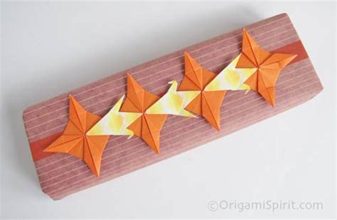 Origami Gift Wrap - what do these origami figures in common