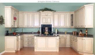 World design encomendas cream kitchen cabinets with black appliances