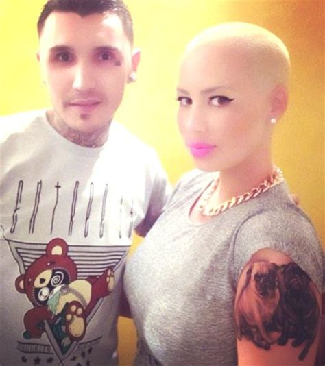 amber rose arm tattoo debuts arm of 2 dogs