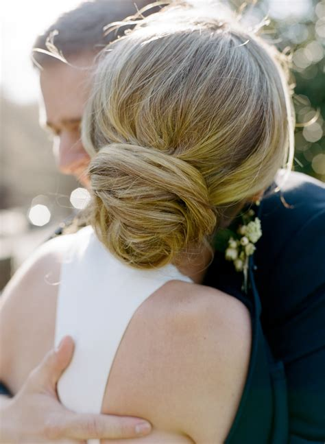 Bridal Hairstyles Low Bun With Flowers by Bridal Hairstyles Low Bun With Flowers Fade Haircut