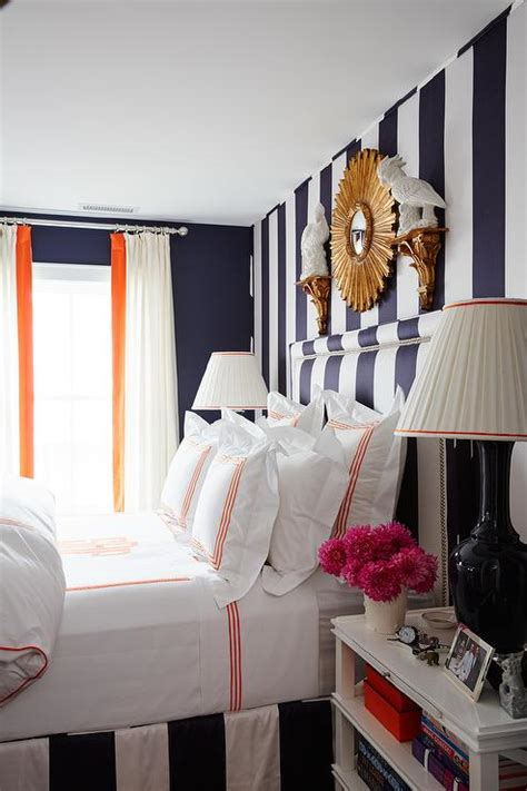 black and white bedroom with hermes orange accents