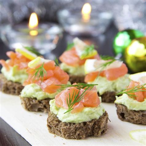 nibbles and canapes appetizer canapes of bread with avocado and fish