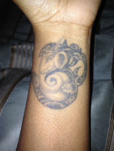 ganesh tattoo meaning my meaning the om symbol is what encircles all