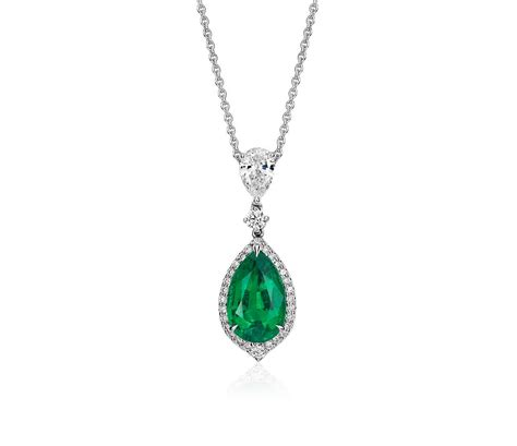 pear shape emerald and pav 233 halo drop pendant in
