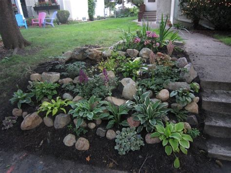 Rock Backyard Landscaping Ideas Backyard Landscaping Ideas For Small Yards With Various Herb Plants Sloping Garden And Rocks
