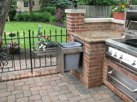brick granite limestone outdoor kitchen traditional patio columbus by aspen fireplace
