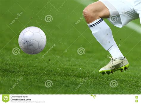 white shoes football player up of soccer player with football on field royalty