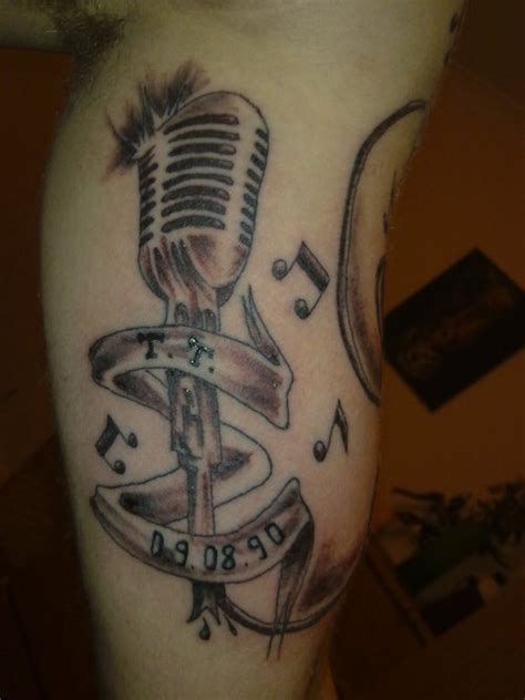 tattoo of a microphone 301 moved permanently