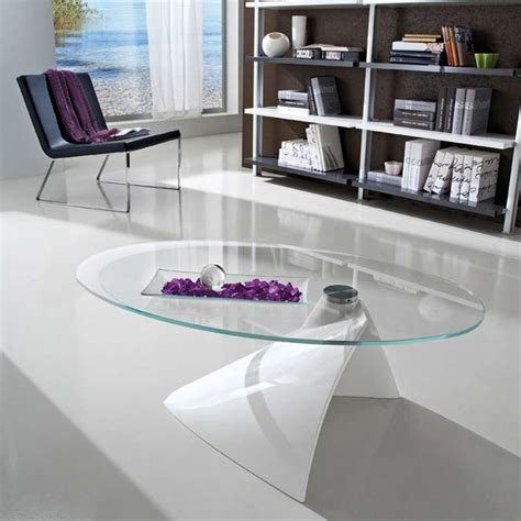 table basse design ovale en verre 4 pieds