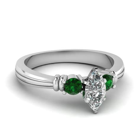 marquise shaped engagement ring with green emerald