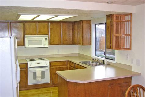 how do i paint kitchen cabinets how do i paint my kitchen cabinets white jocelyn trainor