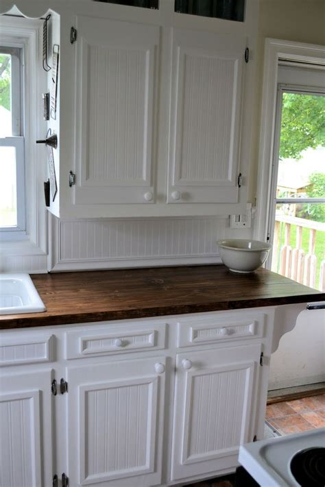 beadboard with trim kitchen inspiration pinterest kitchens with stained wooden baseboards we used chair