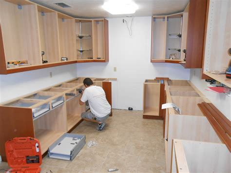 Installing Cabinets by How To Install Kitchen Wall And Base Cabinets Builder