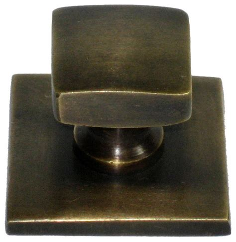 square knob with oversized backplate cabinet and drawer