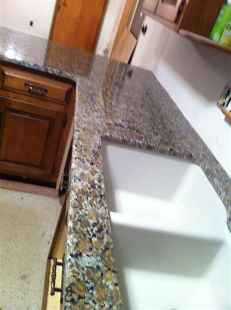 Ferro Gold Granite countertop with Granite composite sink