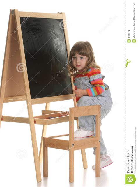 little girl on chair little girl climbing on a chair stock images image 8853274
