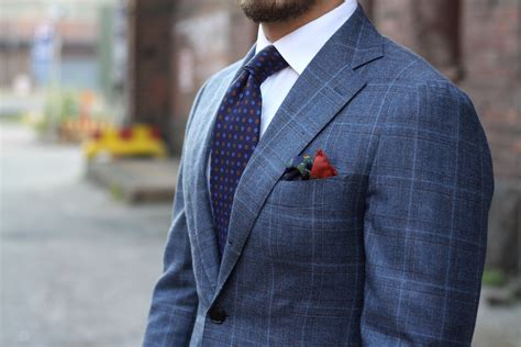 blue pattern suit printed silk tie with a gray suit dress like a