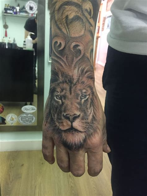 lion tattoo on finger 25 best ideas about on