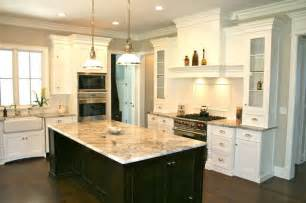 white kitchen cabinets with black island the white cabinets island kitchen design