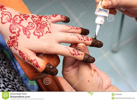 human production tattoo being decorated with henna royalty free stock photos