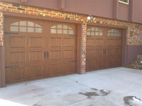 insulated garage doors with windows clopay gallery collection carriage style ultragrain finish