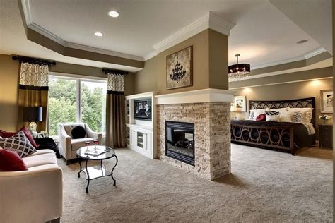 rise  shine master suite  sitting room   sided fireplace  exclusive house plan