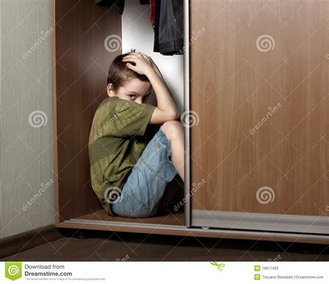 Hiding In The Closet by Sad Boy Hiding In The Closet Stock Photography Image
